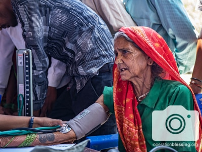 An elderly woman in Nepal receives care through a health camp by Revive Team and Operation Blessing.