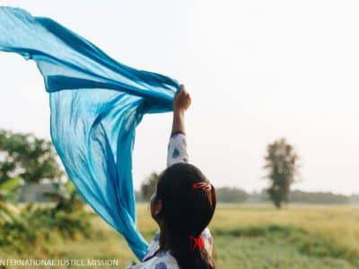 Like the beautiful turquoise scarf flowing in the wind, Sadhna is no longer held in a trap, but is now free.