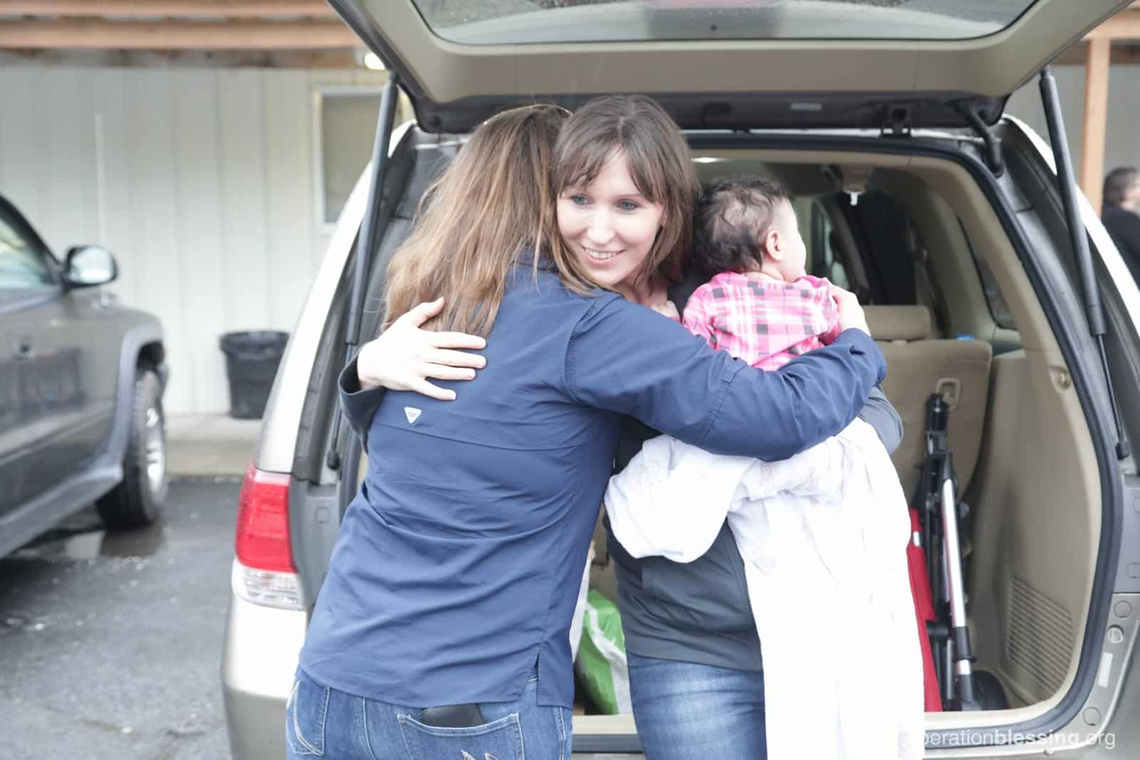 Lakashah receives a hug and help from Operation Blessing.