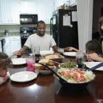 Daniel, Lakashah, and their children, seen here praying over dinner, were in desperate need due to a loss of income and medical bills, until they found Operation Blessing and Warehouse of Hope.