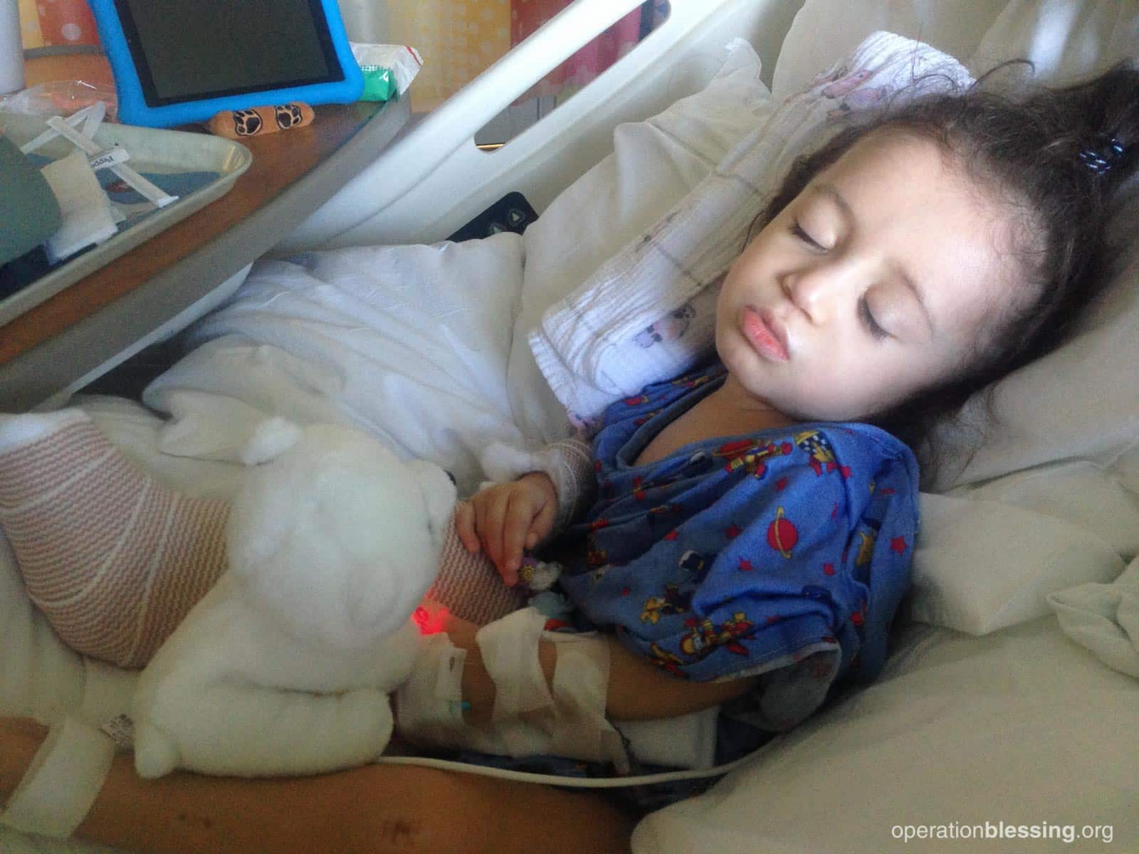 Daniella lying in a hospital bed, suffering from a genetic disorder.