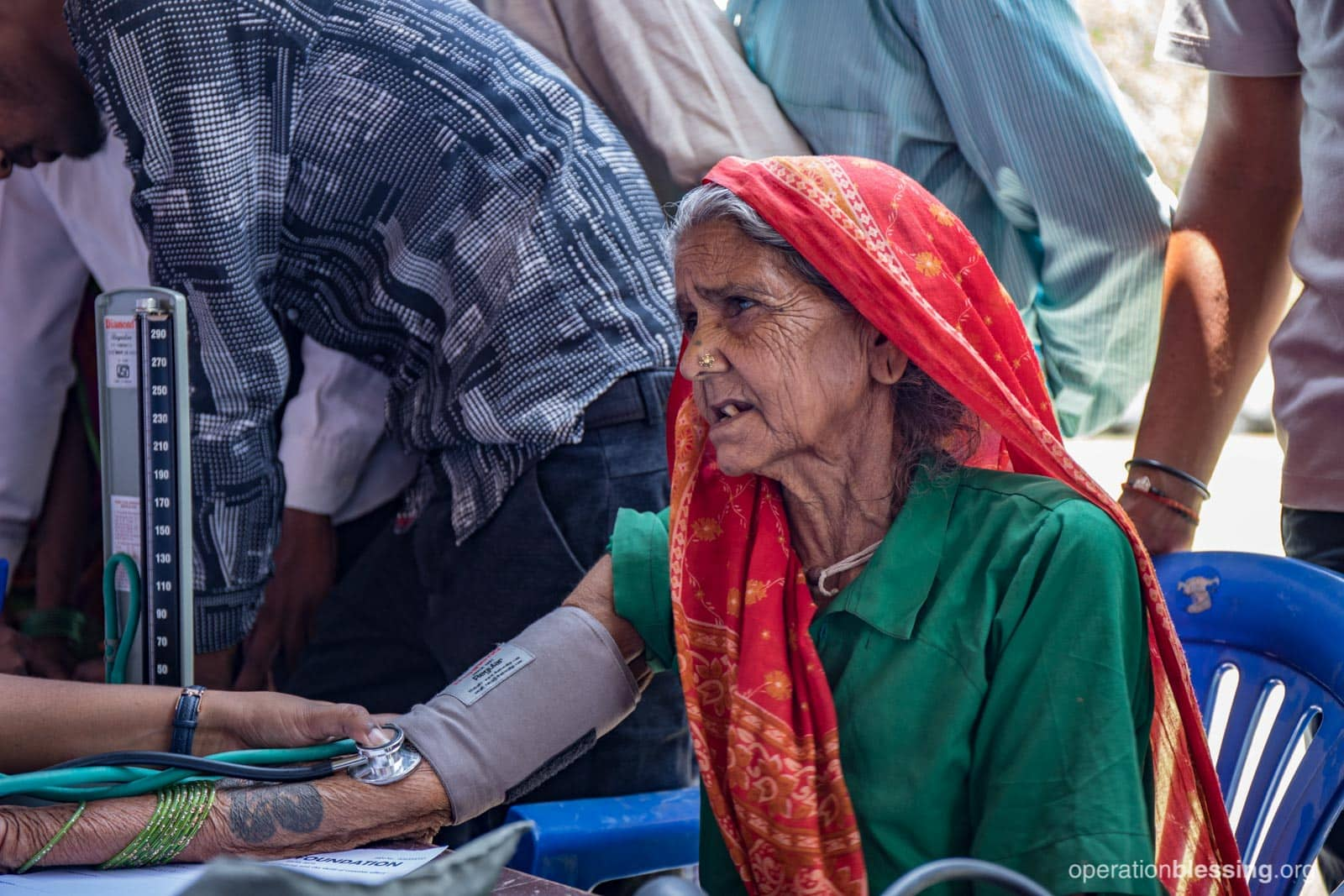 An elderly woman in Nepal received medical care.