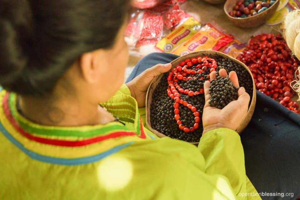 Loily with new beads from Operation Blessing.