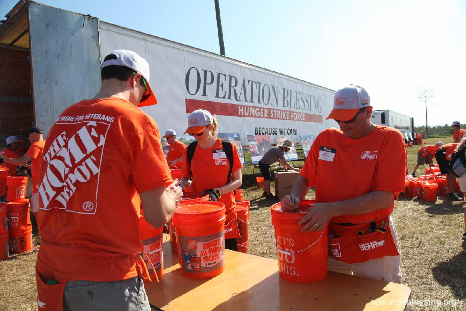 Home Depot volunteers pack Operation Blessing relief trucks with flood kits to prepare for storms like Hurricane Florence.