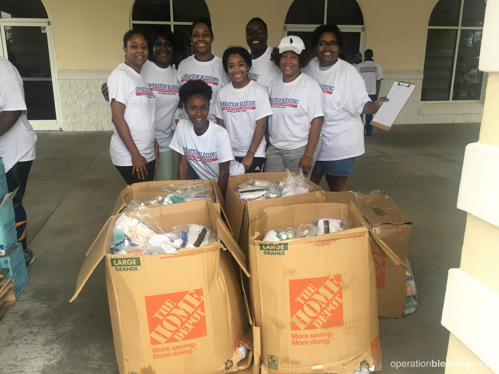 Volunteers with hygiene supplies for hurricane victims.