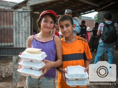 Victims of the Mexico Flood receive hot meals.