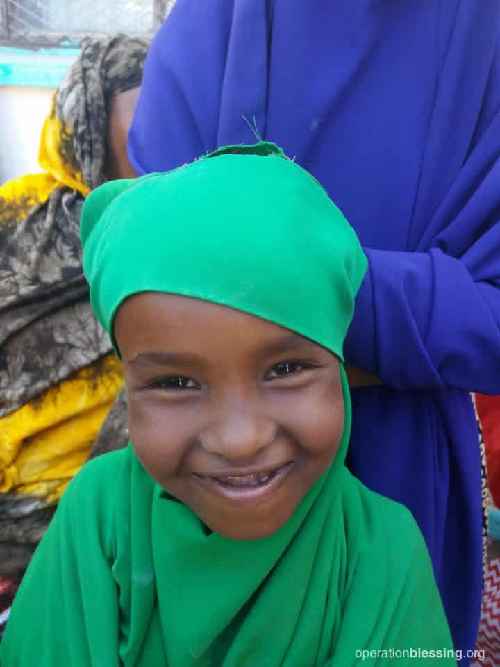 One of the special needs girls smiling.