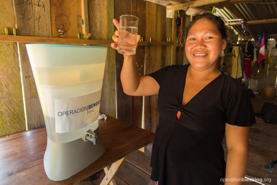 Missleny with her new Kohler water filter.