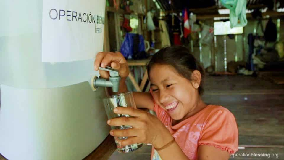 Marisol getting clean water from the Kohler filter.