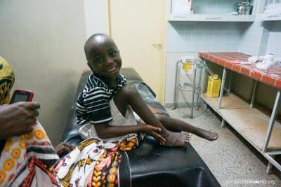 Majawala sits in the MiracleFeet clinic after overcoming many obstacles.
