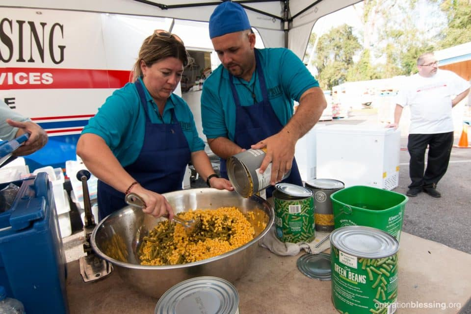 A chef and volunteer from San Juan prepare food for Hurricane Florence victims in North Carolina.