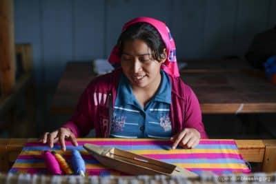Irma weaving beautiful fabrics.