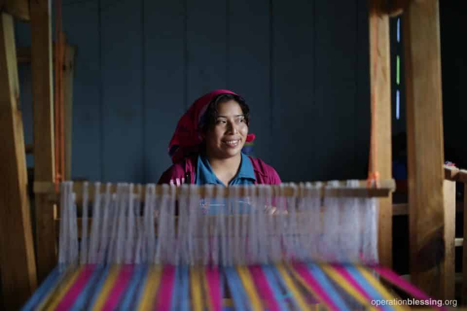 Irma at her new weaving loom.