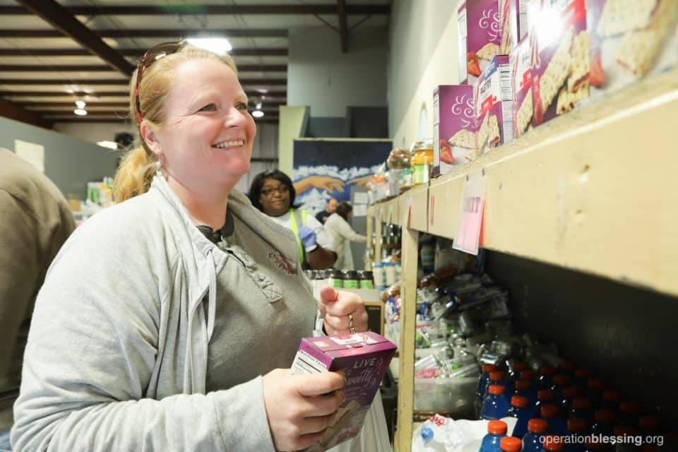 Danielle smiles as she helps at Warehouse of Hope.