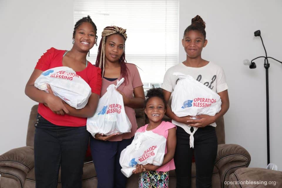 Tiffanie and her daughters received the gift of food on the table thanks to OBI's Project Lunchbox.