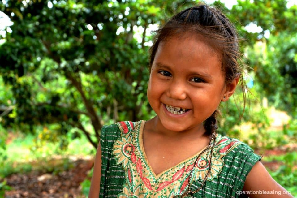 Deepana is bright-eyed and smiling now that her health has been restored.