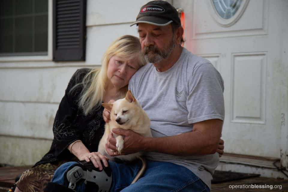 Hurricane victims and their dog, helped by Operation Blessing