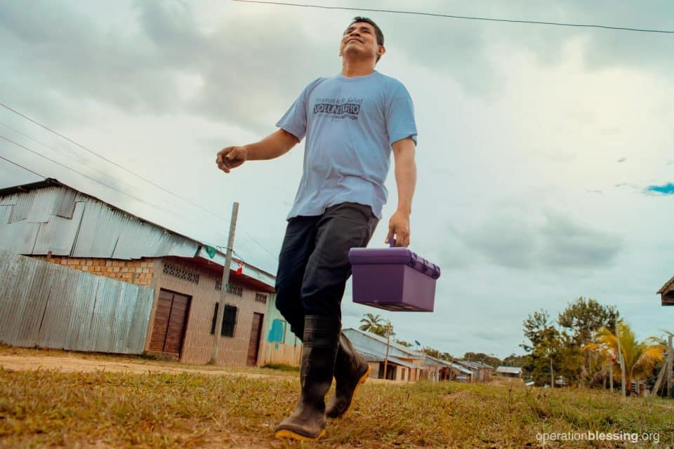 Fermin serving his village as a Community Health Worker.