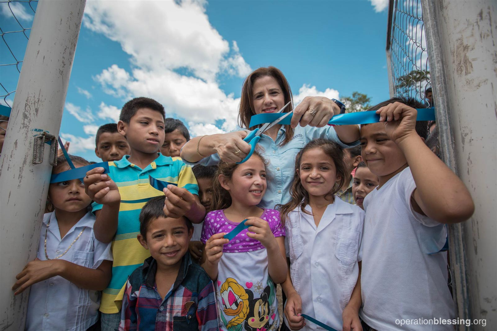 The villagers of Agua Buena cut a ribbon, unwrapping the gift of safe water.