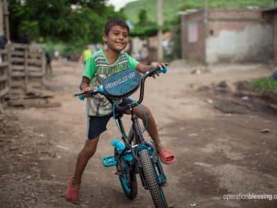 Angel nearly drowned in a flood, but thanks to OBI partners he has a new beginning and a new bike.
