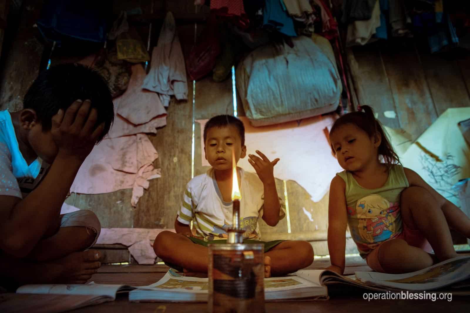 Doing homework by dangerous lamp light.