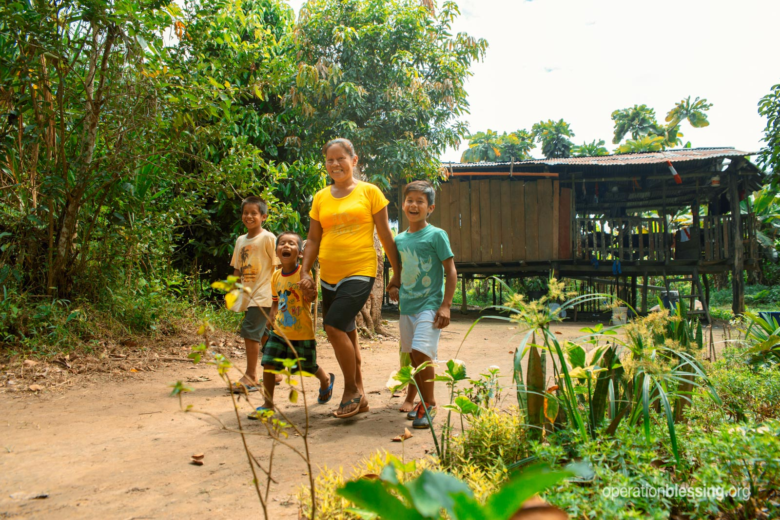 Rosa walking with her children.