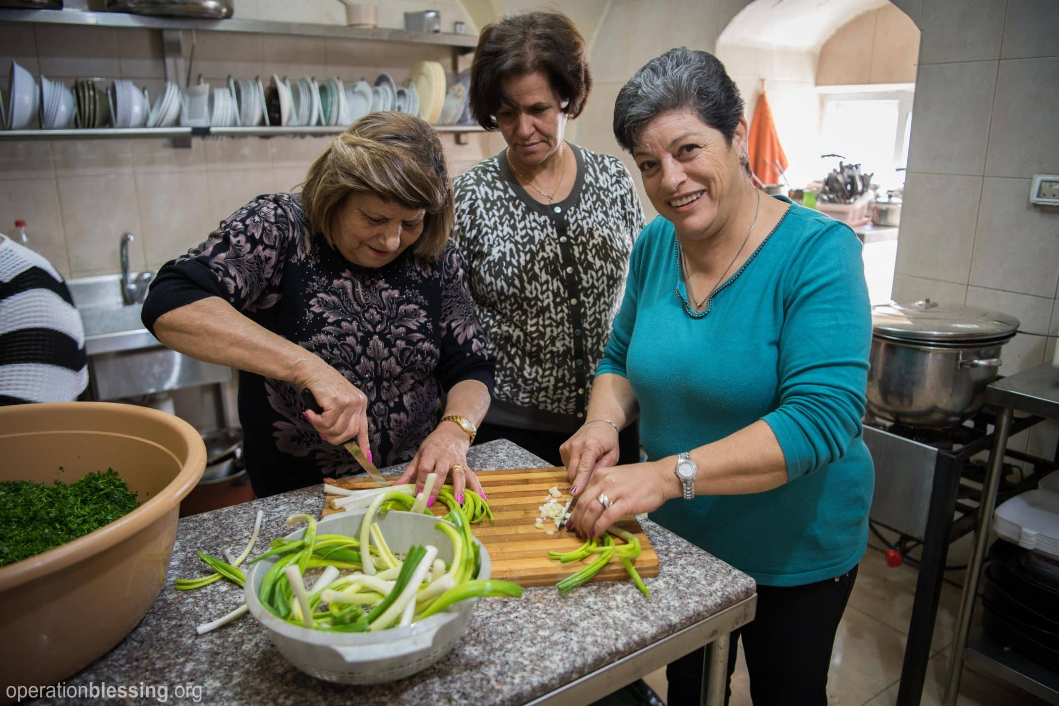 Women cooking to feed the hungry.