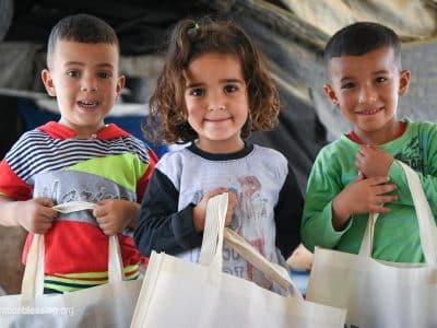Children in the Holy Land receive food.