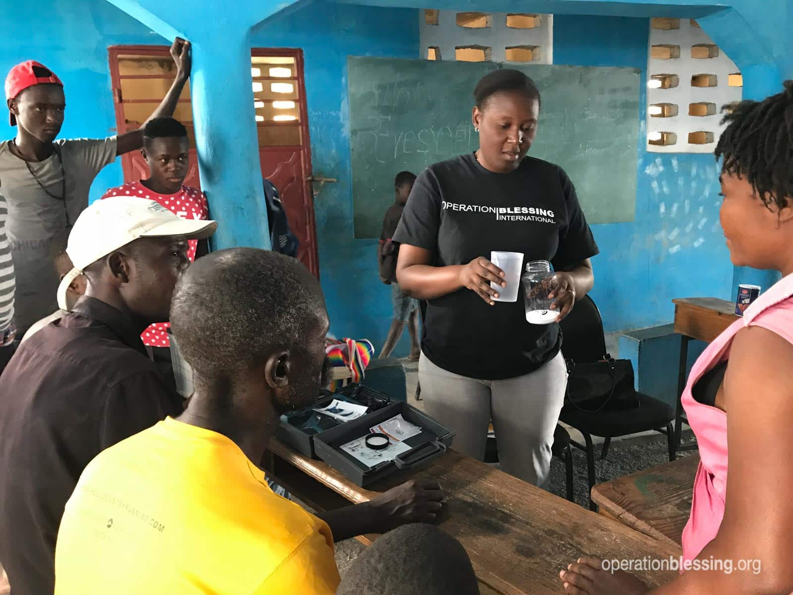 Haitian villagers being trained to use chlorine generators.