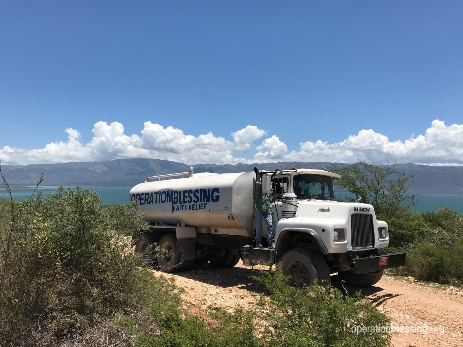 A truck making a delivery of safe water supplies.