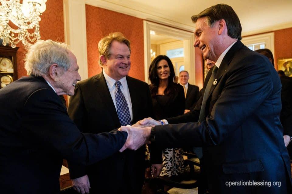 Operation Blessing founder Pat Robertson and president Gordon Robertson meet with Brazilian president Jair Bolsonaro.