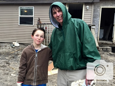 Father and son flood victims from Nebraska receive flood relief from Operation Blessing.