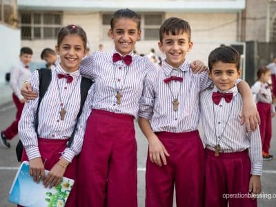 Wisam's children dressed in uniforms for school - part of their new life in a new land.