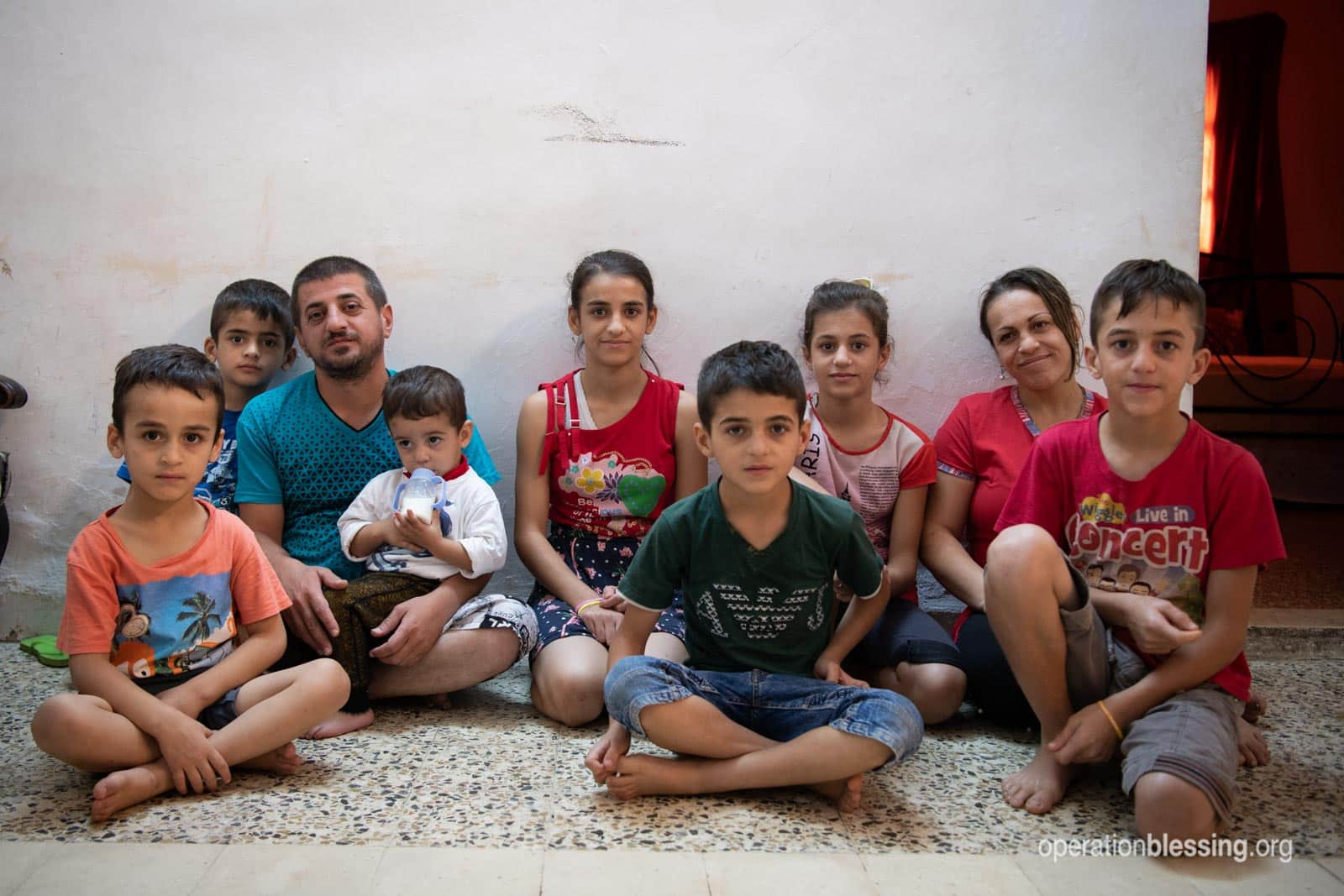Wisam with his wife and family - persecuted Christians who fled Iraq for a new life in a new land.