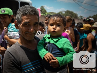 Father and child are refugees of the Venezuelan humanitarian crisis.