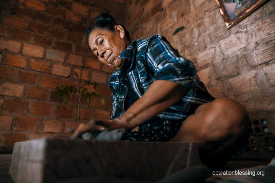 Juana molding her pottery in a remote village of Peru.