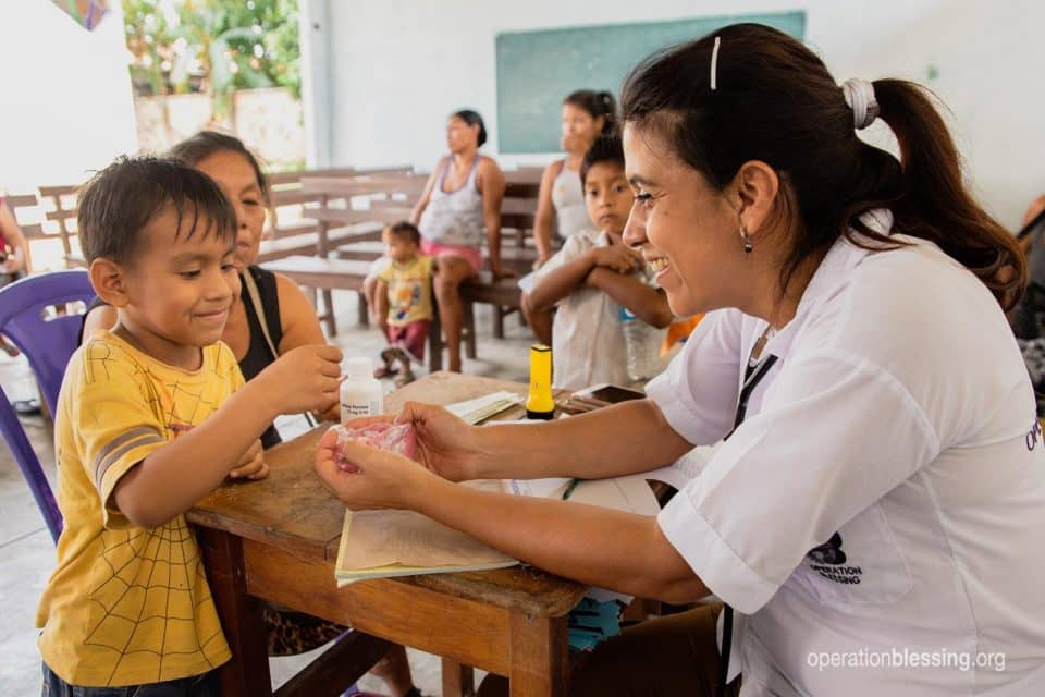 Juana and her grandson receive medical care from Operation Blessing.