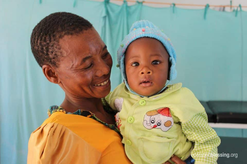 Vicent's mother smiles at him during his clubfoot treatments.