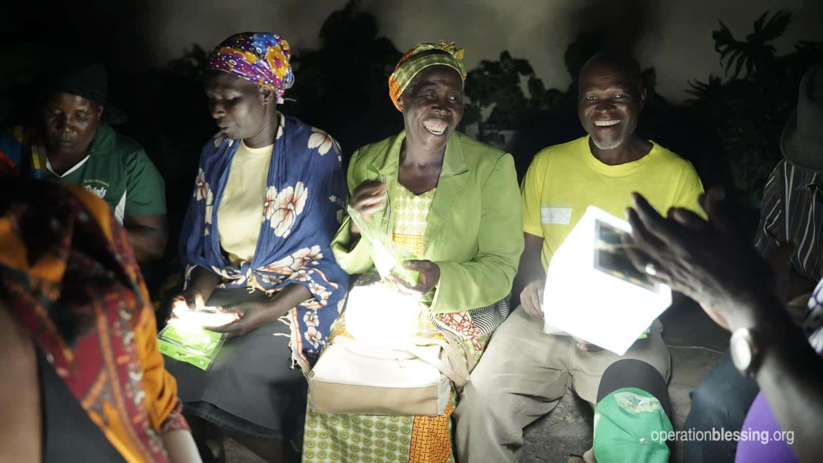 Elderly woman in small village in Zimbabwe receive solar lamps after Cyclone Idai