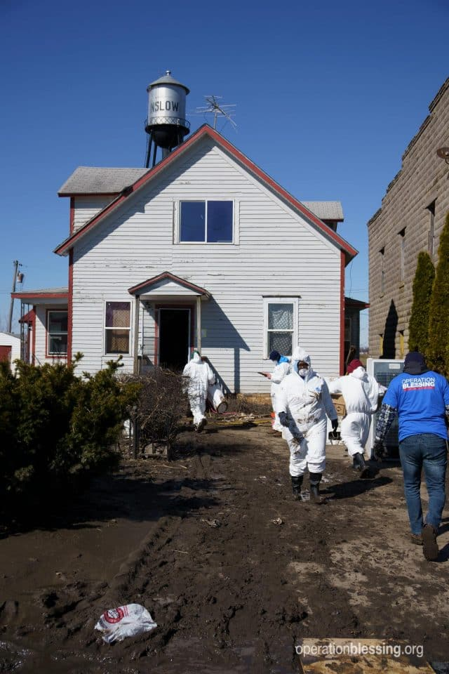 OB staff and volunteers work to clean out a flood damaged home in Winslow, Nebraska.