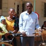 Vicent's committed parents rode him on this bike to his clubfoot treatments