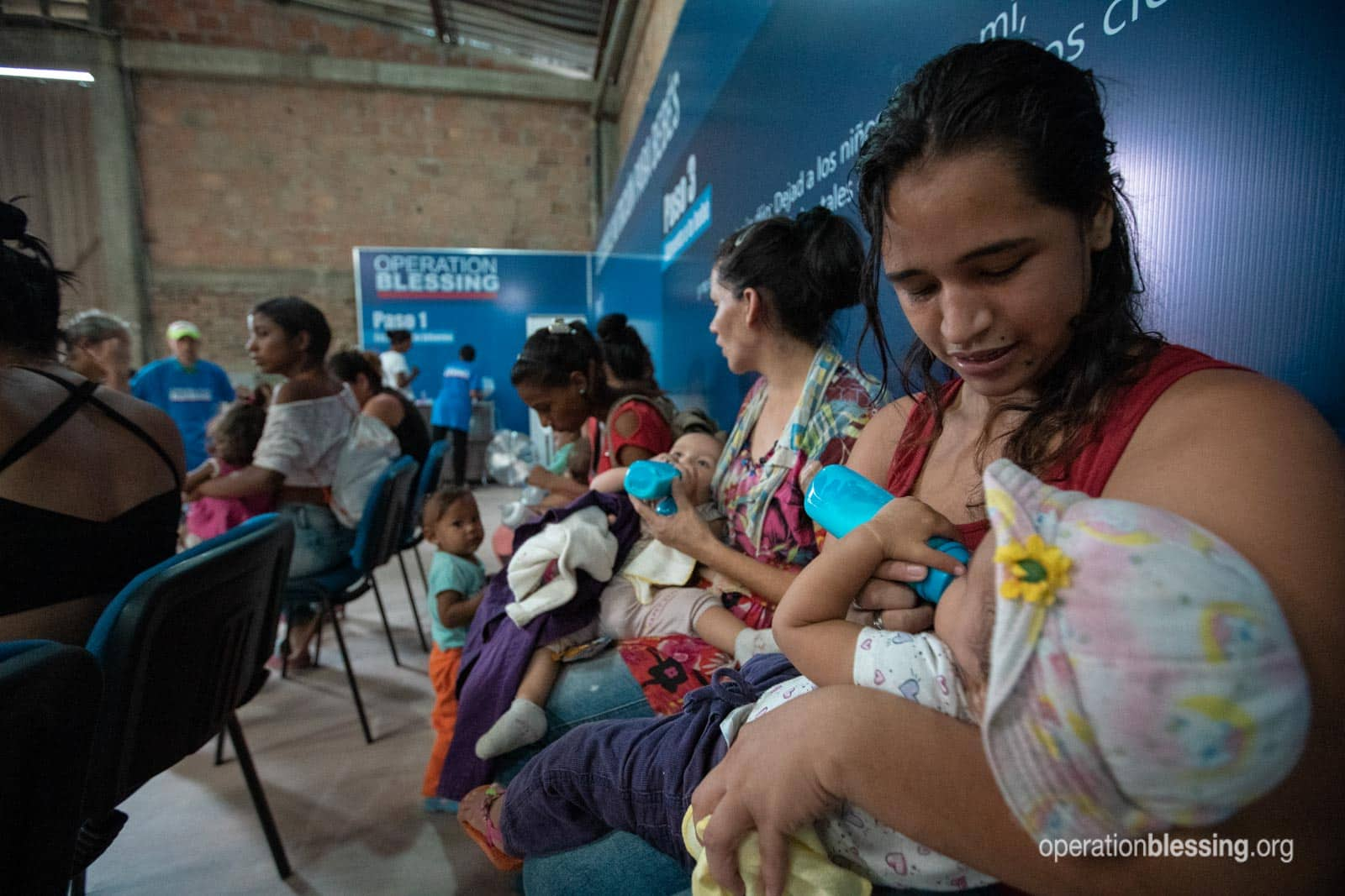 A baby feeding station for Venezuelan refugees provides proper nutrition for these malnourished babies.