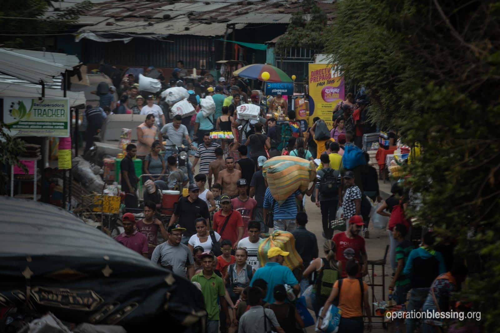 Huge mobs of refugees fleeing the crisis in Venezuela.