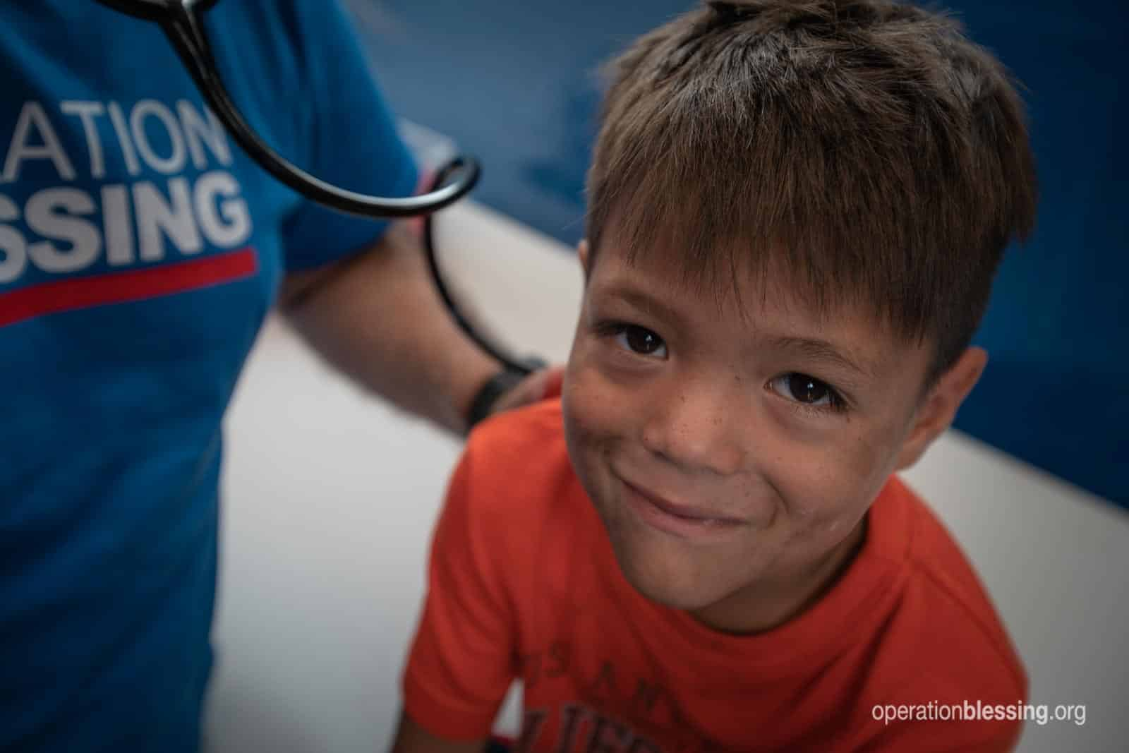 Young Venezuelan refugee Joel receives medical care.