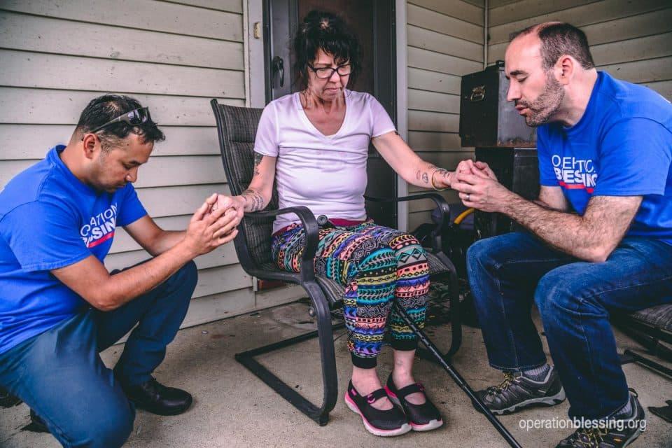 Praying with Dayton Tornado victim.