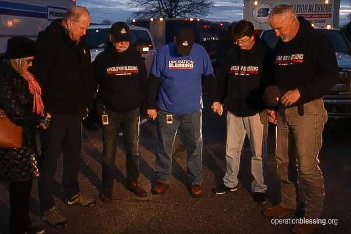 The team prays as Operation Blessing sends relief to the Dayton tornado victims.