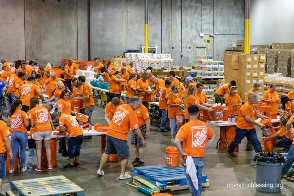 Volunteers racing to pack supplies.