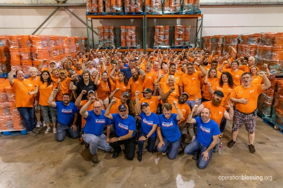 Operation Blessing and Home Depot volunteers teaming up.