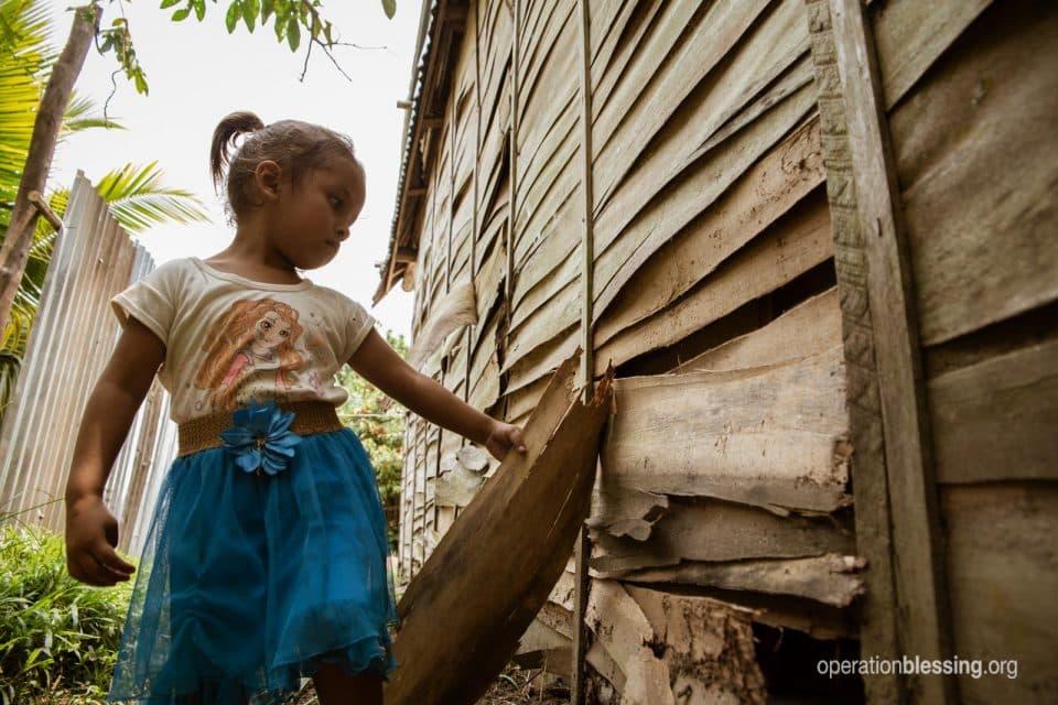 Esmerelda shows their broken down, unsafe house before.