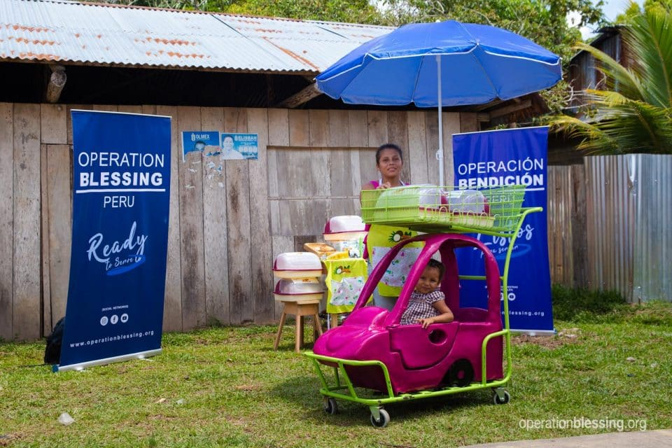 Esmerelda rides in the new candy cart, complete with a pink toy car for her to sit in.